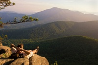 relaxing on rocks looking at blue ridge mountains